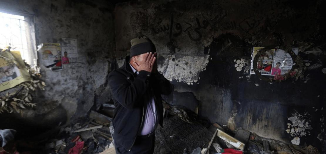 منزل عائلة الدوابشة الفلسطينية في بلدة دوما بعد حرقه في العام 2015 (أ ف ب)