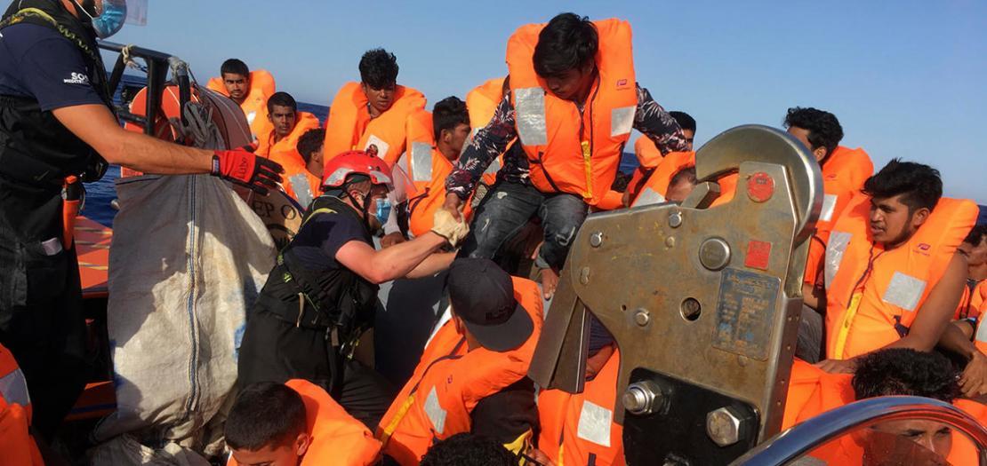 """قسم من المهاجرين الذين انقذتهم سفينة """"اوشن فايكينغ""""، 25 حزيران 2020"""